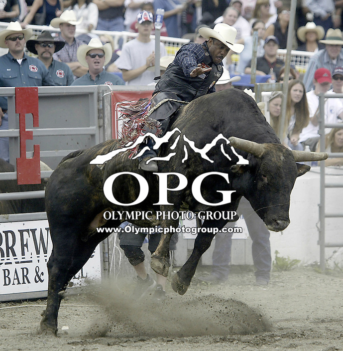 "29 August, 2004:  PRCA Rodeo Bull Rider Mike Moore ranked 50th in the world riding the bull ""Hard Head""  during the PRCA 2004 Extreme Bulls competition in Bremerton, WA."