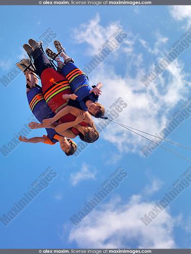 People enjoying Xtreme Skyflyer free-fall swing sky coaster at Canada's Wonderland amusement park. Vaughan Ontario Canada.