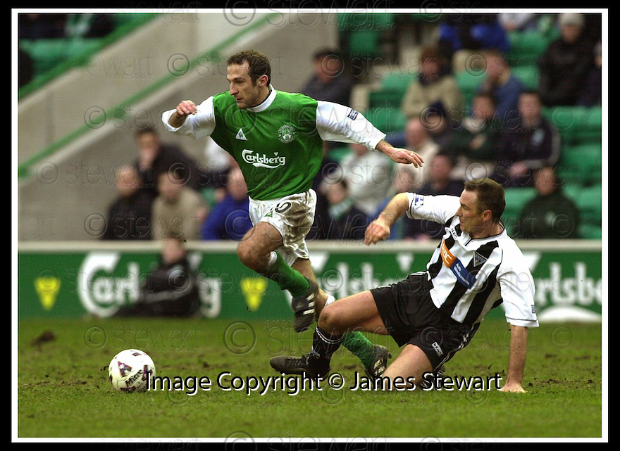 16/02/2002                 Copyright Pic : James Stewart .Ref :     .File Name : stewart-hibs v dunfermline 10.DUNFERMLINE'S IAN FERGUSON CHALLENGES FREDERIC ARPINON......James Stewart Photo Agency, Stewart House, Stewart Road, Falkirk. FK2 7AS      Vat Reg No. 607 6932 25.Office     : +44 (0)1324 630007     .Mobile  : + 44 (0)7721 416997.Fax         :  +44 (0)1324 630007.E-mail  :  jim@jspa.co.uk.If you require further information then contact Jim Stewart on any of the numbers above.........