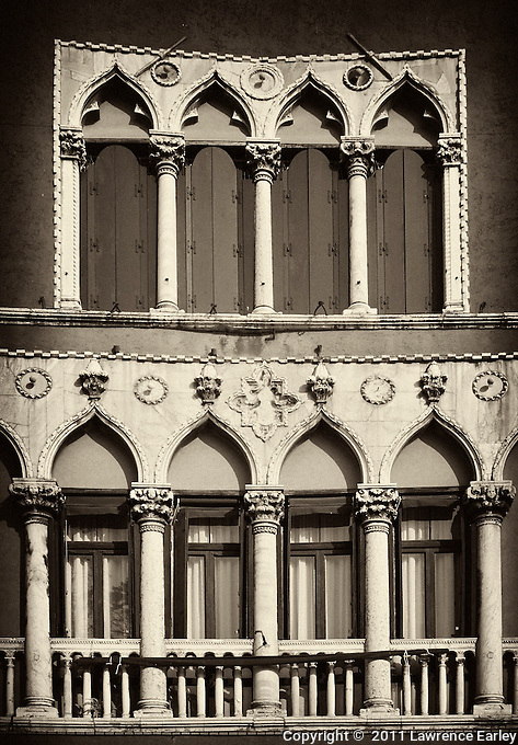 Facade of the Palazzo Soranzo in Campo San Polo, one of the largest piazzas in Venice. This palazzo shows off the Gothic element (pointed arches) that is so characteristic of much Venetian architecture.