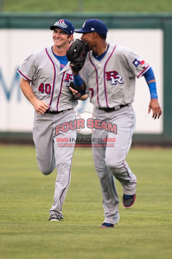 Engel Beltre (7) and Jared Hoying (40) of the Round Rock Express talk in the outfield during the Pacific Coast League game against the Oklahoma City RedHawks at Chickashaw Bricktown Ballpark on June 14, 2013 in Oklahoma City ,Oklahoma.  (William Purnell/Four Seam Images)