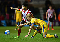 Lincoln City's Josh Ginnelly vies for possession with Chester's Sam Hughes<br /> <br /> Photographer Chris Vaughan/CameraSport<br /> <br /> Vanarama National League - Lincoln City v Chester - Tuesday 11th April 2017 - Sincil Bank - Lincoln<br /> <br /> World Copyright &copy; 2017 CameraSport. All rights reserved. 43 Linden Ave. Countesthorpe. Leicester. England. LE8 5PG - Tel: +44 (0) 116 277 4147 - admin@camerasport.com - www.camerasport.com