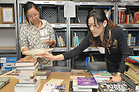 Yale Day of Service at New Haven Reads. L to R: Yen Cu, Gaduate School, BME. Grace Chen, Spouse of Yale Graduate Student.