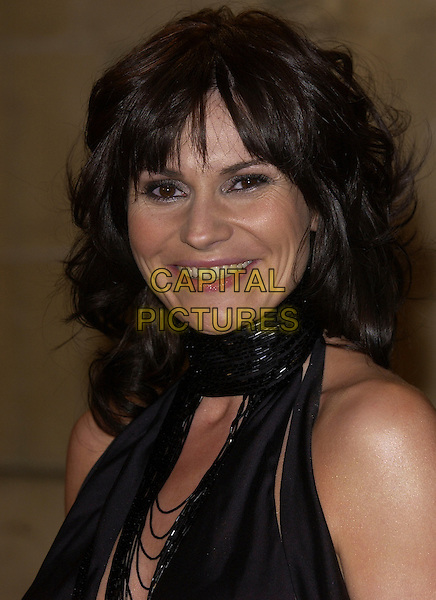 LUCY PARGETER.National Television Awards 2005 at the Royal Albert Hall..London, United Kingdom.Ref: FIN.portrait headshot Emmerdale black silk satin top long eye skimming fringe smiling.www.capitalpictures.com.sales@capitalpictures.com.© Capital Pictures .
