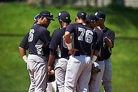 GCL Yankees 1 pitching coach Elvys Quezada (sunglasses on hat) talks with pitcher Anderson Severino (68) as catcher Jerry Seitz, Donny Sands, Wilkerman Garcia, Bryan Cuevas and Victor Rey (76) listen in during the first game of a doubleheader against the GCL Tigers on August 5, 2015 at Tigertown in Lakeland, Florida.  GCL Tigers derated the GCL Yankees 5-2.  (Mike Janes/Four Seam Images)