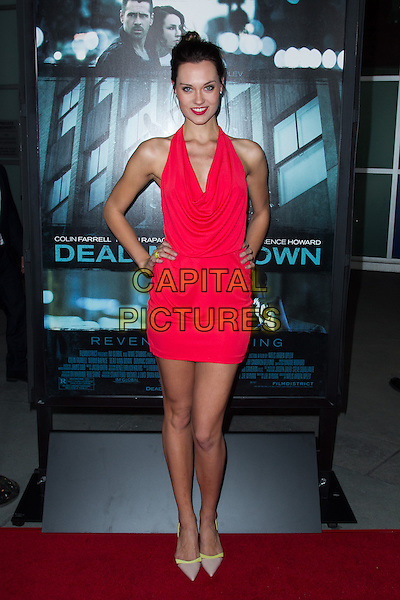 Laura james.The premiere of FilmDistricts's 'Dead Man Down' at ArcLight Hollywood, Hollywood, California, USA..February 26th, 2013.full length red halterneck cowl neck beige shoes dress hands on hips lipstick .CAP/ADM/JS.©John Salangsang/AdMedia/Capital Pictures.