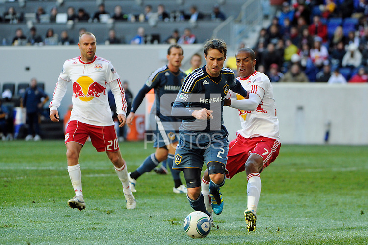 Todd Dunivant (2) of the Los Angeles Galaxy looks to get past Roy Miller (7) of the New York Red Bulls during the 1st leg of the Major League Soccer (MLS) Western Conference Semifinals at Red Bull Arena in Harrison, NJ, on October 30, 2011.
