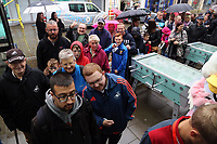 A queue of fans and supporters outside Swansea City FC shop before its opening in Union Street, Swansea, Wales, UK. Saturday 07 October 2017