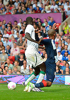 July 26, 2012..Britain's Daniel Sturridge (9), tackled by Senegal defender. Great Britain vs Senegal Football match during 2012 Olympic Games at Old Trafford in Manchester, England. Senegal held Great Britain to a 1-1 draw...(Credit Image: © Mo Khursheed/TFV Media)