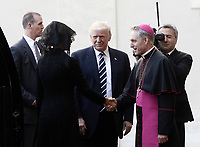 US President Donald Trump and his wife Melania are welcomed by Archibishop Mons. Georg Gaenswein, as they arrives at the San Damaso courtyard for a private audience with Pope Francis, at the Vatican, May 24, 2017.<br /> UPDATE IMAGES PRESS/Isabella Bonotto<br /> STRICTLY ONLY FOR EDITORIAL USE