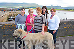 "HAPPY BIRTHDAY: Maíre Uí Neill, Cloghane (2nd left) who celebrated her birthday at  the Brandon regatta last Sunday afternoon, l-r: Triona Ní Neill, Maíre Uí Neill, Trish Maunsell, Poppy Overy, Una O'Neill with the Irish wolf hound ""Boadicea"""