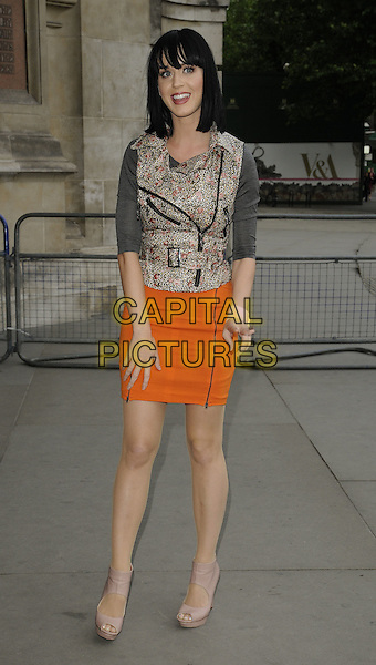 KATY PERRY.Lulu Guinness' 20th Anniversary Party at the Victoria and Albert Museum, London, England..June 8th, 2009.V&A V & A full length pink beige open toe platform sandals orange zip zipper skirt grey gray top silver sleeveless vest leopard print.CAP/CAN.©Can Nguyen/Capital Pictures.
