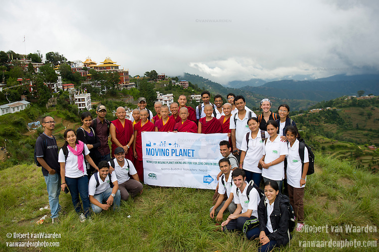 Monks at the Namo-Buddha Monastery outside Kathmandu and members of Small Earth Nepal pose with a Moving Planet banner on Sept 24, 2011. This action joined thousands of others taking part in the Moving Planet day of action.