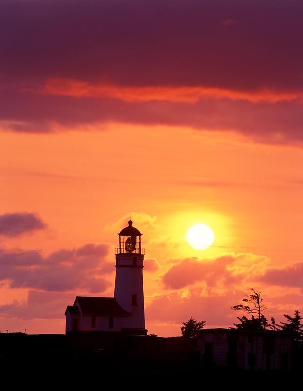 Cape Blanco Lighthouse with setting sun, Oregon
