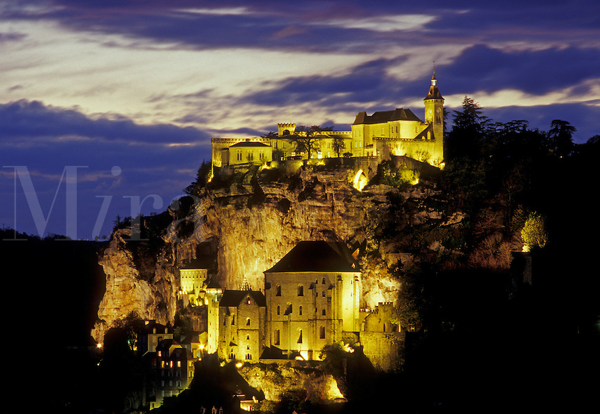 Rocamadour, Perigord, Dordogne, France, Lot, Midi-Pyrenees, Europe, The fortified pilgrimage town of Rocamadour situated on the terraced limestone cliffs is illuminated at night.
