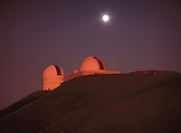 Canada-France-Hawaii Telescope (left) and NASA Infrared Telescope Facility (right), with the Moon rising behind them, Mauna Kea Observatory, Hawaii