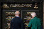 Two men looking at the  memorial to the victims of the fire in 1985 which destroyed part of the ground pictured before Bradford City played Carlisle United in a Skybet League 2 fixture at Valley Parade. The home team were looking to bounce back after being relegated during a disastrous 2018-19 season on and off the pitch. Bradford won the match 3-1, watched by a crowd of 14, 217.