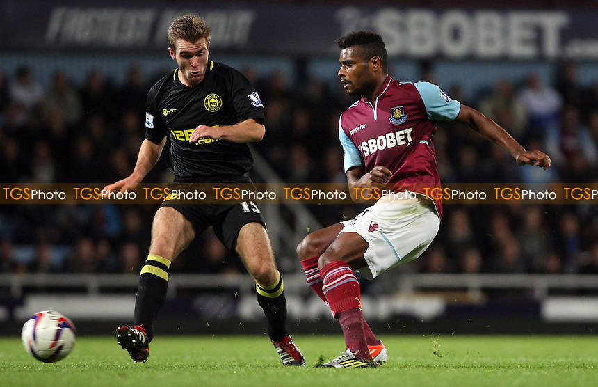 Ricardo Vaz Te of West Ham and Callum McManaman of Wigan - West Ham United vs Wigan Athletic, Capital One Cup 3rd Round at Upton Park, West Ham - 25/09/12 - MANDATORY CREDIT: Rob Newell/TGSPHOTO - Self billing applies where appropriate - 0845 094 6026 - contact@tgsphoto.co.uk - NO UNPAID USE.