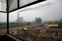 A view of the Quzhou Juhua Chemical Factory seen from a nearby abandoned apartment in Quzhou, China..21 Nov 2006..