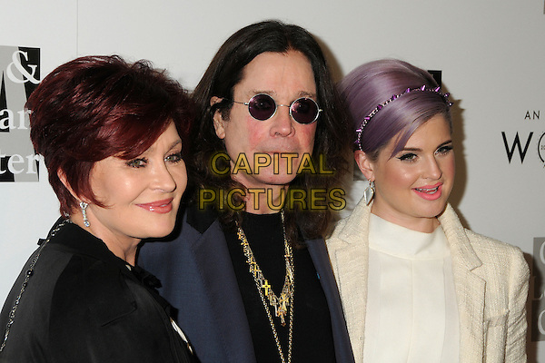 """Sharon Osbourne, Ozzy Osbourne, Kelly Osbourne.LA Gay & Lesbian Center's """"An Evening With Women"""" 2013 held at the Beverly Hilton Hotel, Beverly Hills, California, USA, 18th May 2013..half length black white shirt clutch bag gold necklaces husband wife couple married daughter parents family jacket suit beige cream coat hairband purple dyed hair band spikes studs .CAP/ADM/BP.©Byron Purvis/AdMedia/Capital Pictures"""