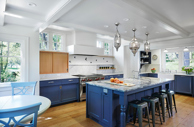 This kitchen's backsplash is in motion with Flight, a water jet and hand chopped mosaic in Blue Macauba and polished Thassos.<br /> <br /> Photo by Corey Gaffer: http://www.gafferphotography.com/