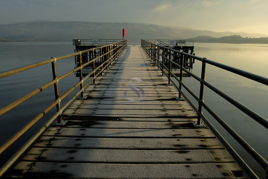 Luss Pier at dawn overlooking Loch Lomond  Scotland. Luss was the setting for the TV programme Take the High Road<br /> <br /> Copyright www.scottishhorizons.co.uk/Keith Fergus 2011 All Rights Reserved