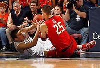 Virginia forward/center Mike Tobey (10) fights for a loose ball with Maryland center Alex Len (25) during the game Sunday in Charlottesville, VA. Virginia defeated Maryland in overtime 61-58. Photo/Andrew Shurtleff