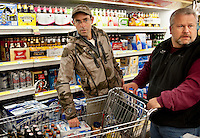 OutdoorLife Editor Andrew McKean (cq, left) and PR and Web Director for the National Wild Turkey Federation Brent Lawrence (cq) buy beer in preparation for a four day hunting trip in and around Superior, Nebraska, Wednesday, November 30, 2011. ..Photo by Matt Nager