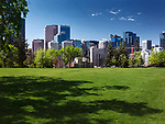 Calgary city downtown skyline sunny summer day scenery from Sunnyside Bank city park. Calgary, Alberta, Canada 2017.