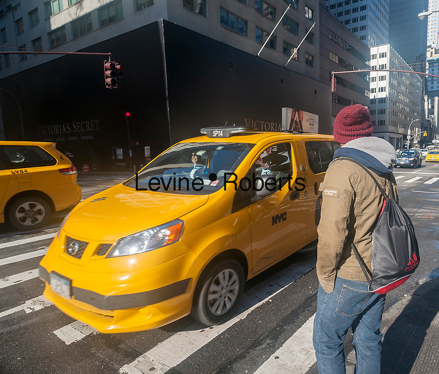 Taxis go about their business on Fifth Avenue in New York on Friday, February 5, 2016.   (© Richard B. Levine)
