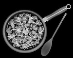 X-ray image of stir fry (white on black) by Jim Wehtje, specialist in x-ray art and design images.