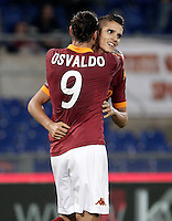Calcio, Serie A: Roma vs Palermo. Roma, stadio Olimpico, 4 novembre 2012..AS Roma forward Erik Lamela, of Argentina, right, is hugged by teammate Pablo Daniel Osvaldo after scoring during the Italian Serie A football match between AS Roma and Palermo, at Rome's Olympic stadium, 4 november 2012..UPDATE IMAGES PRESS/Riccardo De Luca