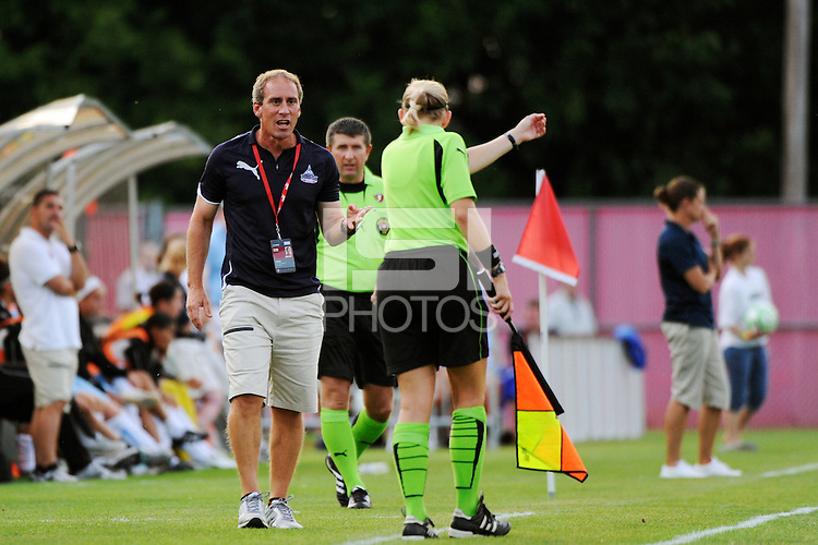 Washington Freedom head coach Jim Gabarra talks with the assistant referee. Sky Blue FC and the Washington Freedom played to a 4-4 tie during a Women's Professional Soccer match at Yurcak Field in Piscataway, NJ, on July 15, 2009.