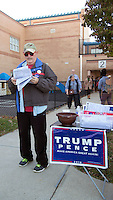 Alexandria, VA,November 8, 2016, USA:   A Trump supporter passes out literature at one of the polling sites in Alexandria, VA Polls opened in Virginia at 6 A.M and long lines were present as voters make their voices heard in the 2016 Presidential elections.  Patsy Lynch/MediaPunch