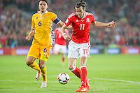 Gareth Bale of Wales scores his side's third goal under pressure from Alexandru Epureanu of Moldova during the FIFA World Cup Qualifier match between Wales and Moldova at Cardiff City Stadium, Cardiff, Wales on 5 September 2016. Photo by Mark  Hawkins.