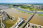 Nederland, Gelderland, Nijmegen, 09-06-2016; Waalhaven met spoorbrug en De Snelbinder (fietsbrug/voetgangersbrug), in de achtergrond de neiwue stadsbrug De oversteek. Parallel aan rivier de Waal de nevengeul ontstaan door de dijkverlegging bij Lent.<br /> The finished dike relocation of Lent (project Ruimte voor de Rivier: Room for the River) with the resulting flood trench. In the foreground new city bridges of Nijmegen.<br /> luchtfoto (toeslag op standard tarieven);<br /> aerial photo (additional fee required);<br /> copyright foto/photo Siebe Swart