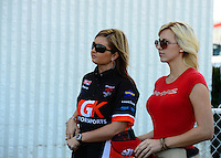 Sept 9, 2012; Clermont, IN, USA: NHRA funny car driver Courtney Force (right) with pro stock driver Erica Enders during the US Nationals at Lucas Oil Raceway. Mandatory Credit: Mark J. Rebilas-