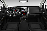 Stock photo of straight dashboard view of 2016 GMC Canyon 2WD SLE Extended Cab 4 Door Pick-up Dashboard