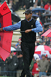 Ryder Cup 206 K Club, Straffin, Ireland...American Ryder cup team player Tiger Woods trying to control his umbrella on the first green during the morning fourballs session of the second day of the 2006 Ryder Cup at the K Club in Straffan, Co Kildare, in the Republic of Ireland, 23 September 2006...Photo: Eoin Clarke/ Newsfile.