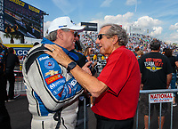 Mar 15, 2019; Gainesville, FL, USA; NHRA funny car driver John Force (left) talks with team owner Don Schumacher during qualifying for the Gatornationals at Gainesville Raceway. Mandatory Credit: Mark J. Rebilas-USA TODAY Sports