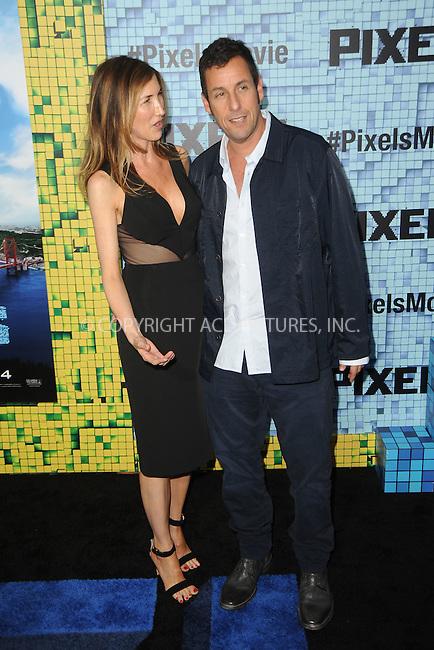 WWW.ACEPIXS.COM<br /> July 18, 2015 New York City<br /> <br /> Jackie Sandler and Adam Sandler attending the 'Pixels' Premiere at Regal E-Walk on July 18, 2015 in New York City.<br /> <br /> Please byline: Kristin Callahan/ACE <br /> <br /> <br /> Tel: (646) 769 0430<br /> e-mail: info@acepixs.com<br /> web: http://www.acepixs.com