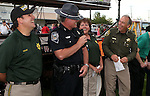 From left, CCSO Chaplain Joel Buxton, NHP Chief Troy Abney, CCSO D.A.R.E. Officer Lisa Davis and Sheriff Ken Furlong make a presentation at the 11th annual National Night Out hosted by the Carson City Sheriff's Office in Carson City, Nev., on Tuesday, Aug. 6, 2013. <br />