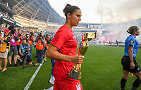 Saint Paul, MN - SEPTEMBER 03: Carli Loyd #10 of the United States carries the 2019 WC trophy during their 2019 Victory Tour match versus Portugal at Allianz Field, on September 03, 2019 in Saint Paul, Minnesota.