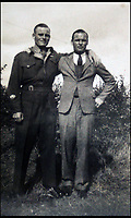 BNPS.co.uk (01202 558833)<br /> Pic: Bellmans/BNPS<br /> <br /> Cooke with his proud father.<br /> <br /> A fascinating trove of SAS records including some of the first photographs of the elite force which have never been seen before has been unearthed. <br /> <br /> The extensive assortment, also including medals and documents, was accumulated by war hero Lance Corporal William James Cooke at the end of World War Two. <br /> <br /> Remarkable images of Cooke's previously unrevealed wartime exploits show him serving behind enemy lines in occupied France and assisting with the liberation of Norway. <br /> <br /> His accomplishments have come to light after a family member presented the bequeathed collection to Hampshire-based auctioneer Bellmans, which will sell it tomorrow.