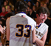 Anthony Reilly #15, right, celebrates with teammate Luke Puccio #33 as the Baymen close in on a 51-31 win over Carle Place in the Nassau County varsity boys basketball Class B final at SUNY Old Westbury on Thursday, Feb. 23, 2017.