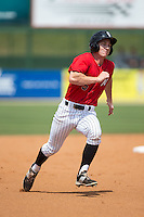 Toby Thomas (5) of the Kannapolis Intimidators hustles towards third base against the Lakewood BlueClaws at CMC-Northeast Stadium on May 17, 2015 in Kannapolis, North Carolina.  The Intimidators defeated the BlueClaws 4-1.  (Brian Westerholt/Four Seam Images)
