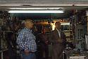Iraq 2015  Men looking at TV in a workshop after a bombing in Ankawa<br />Irak 2015  Clients regardant la television dans un atelier apres un attentat a Ankawa