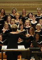 Jeannette Ebelhar (JEANNETTE EBELHAR) conducts the Southern Arizona Women's Chorus (formerly known as the Foothills Women's Chorus), Pope John Paul II High School Advanced Women's Chorus of Hendersonville, TN, St. Cecilia Academy Chorus of Nashville, TN, and the New England Symphonic Ensemble during a performance at Carnegie Hall in New York, NY on Sunday, June 25, 2006.