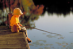 young boy with teddy bear fishing