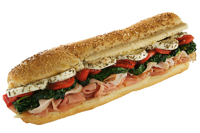 Philadelphia hoagies (submarine sandwiches) photographed for a delicatessen.<br /> <br /> This is called The Louie:  Prosciutto, turkey, sharp provolone, mozzarella, sauteed spinach, roasted red peppers, oil and vinegar on italian stick bread.